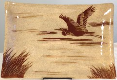 Stoneware platter, sgraffito carved heron in flight